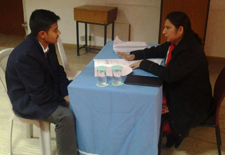 Dr. Anubhuti counselling the students at CCA School Gurgaon